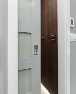 Pocket door open to room with custom walnut cabinetry