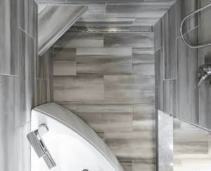 Aerial view of shower with gray modern tile and linear drain