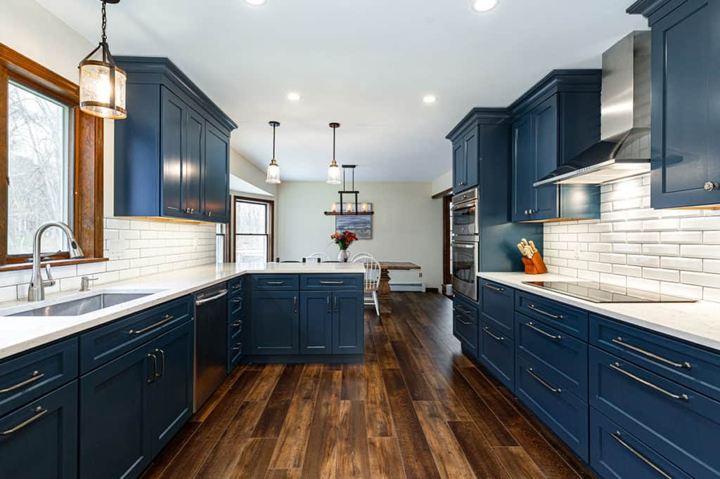 Blue cabinets, hardwood floors and stainless appliances