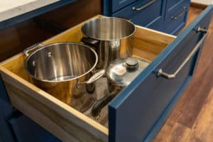 Pots and pans in lower base cabinet drawers