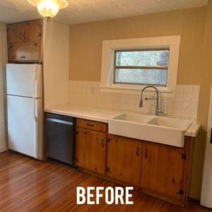Old kitchen with pine cabinets and floors, white farmsink and white backsplash