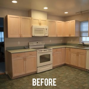 Outdated kitchen with tan cabinets, linoleum floors and corian countertops