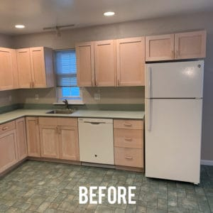 Outdated kitchen with tan cabinets, linoleum floors and green corian countertops