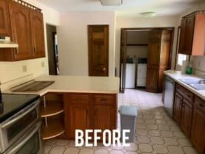 Old outdated kitchen with brown cabinets and formica countertops