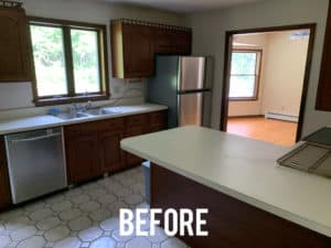 Old outdated kitchen with brown wood cabinets and wall
